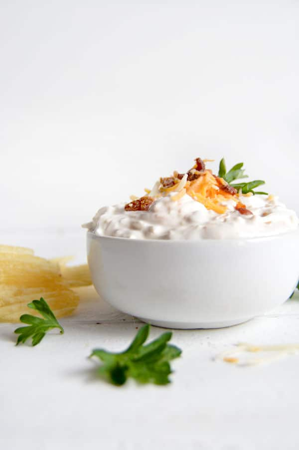 This 3 ingredient dip is the perfect appetizer for your next game day celebration! Everything you love in a baked potato on top of your favorite potato chip! You won't believe how easy this dip is AND you won't want to share!