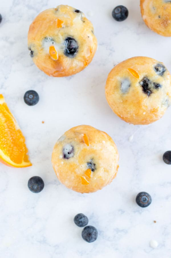 Sweet and tart blueberry orange muffins are one of my favorite flavors for spring! Plus they're one of my all time favorite stand-in-front-of-the-fridge-shoving-your-face late night snacks!