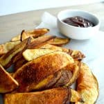 Potato wedges baked in the oven are a healthy alternative to a fried potato wedge. Enjoy these super simple baked potato wedges with your next burger! You won't even believe the secret to a perfect crispy potato wedge!