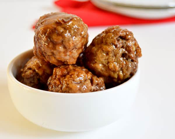 Sriracha and honey come together perfectly as the sweet and spicy sauce covering homemade meatballs! Simmer them all day in the crock pot for an easy but flavorful appetizer!
