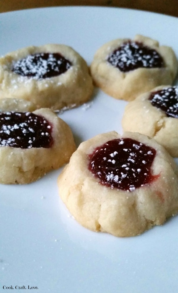 Lemon and raspberry pair perfectly in these buttery thumbprint cookies! Perfect for gift giving or sharing with friends or family these lemon raspberry thumbprint cookies are easier than you might think!