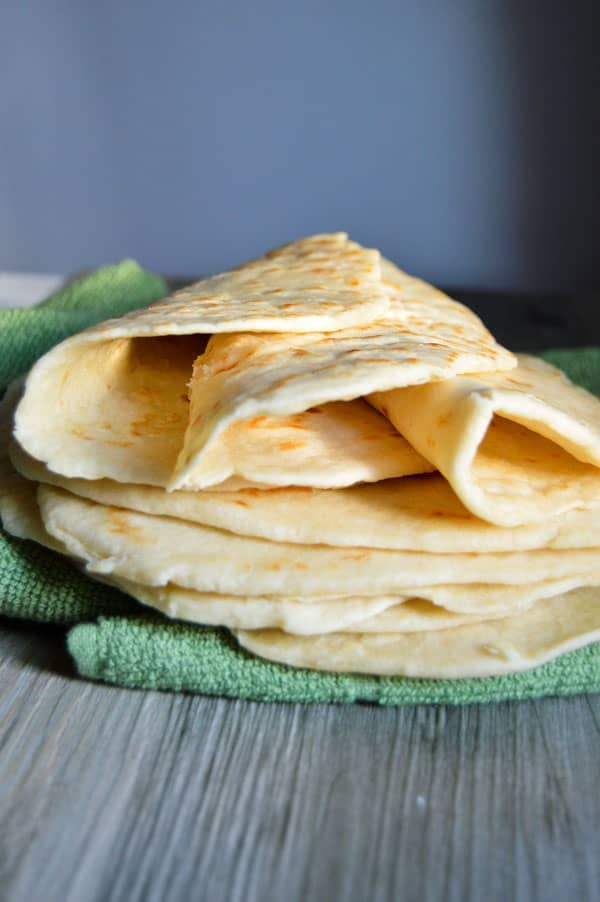 These easy homemade tortillas are a great addition to your next Mexican feast! And because they're made with coconut oil they're healthier for you, too!
