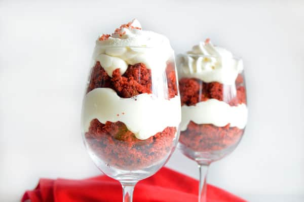 Red velvet cake is the star in this simple and delicious trifle made with vanilla pudding and red velvet cake. Wow your honey this Valentine's Day with this easy red velvet trifle!