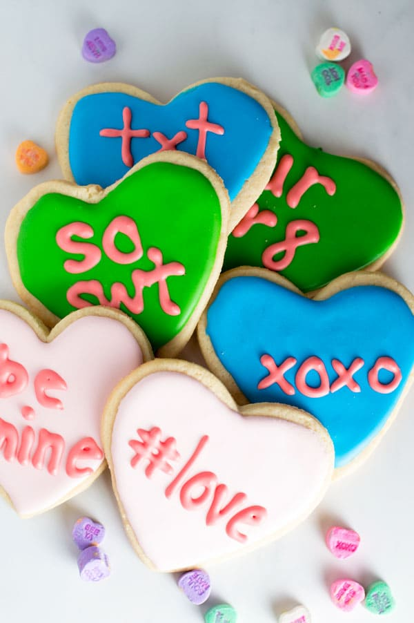 Prepare a sweet treat for your friends and family this Valentine's Day with these conversation heart sugar cookies!