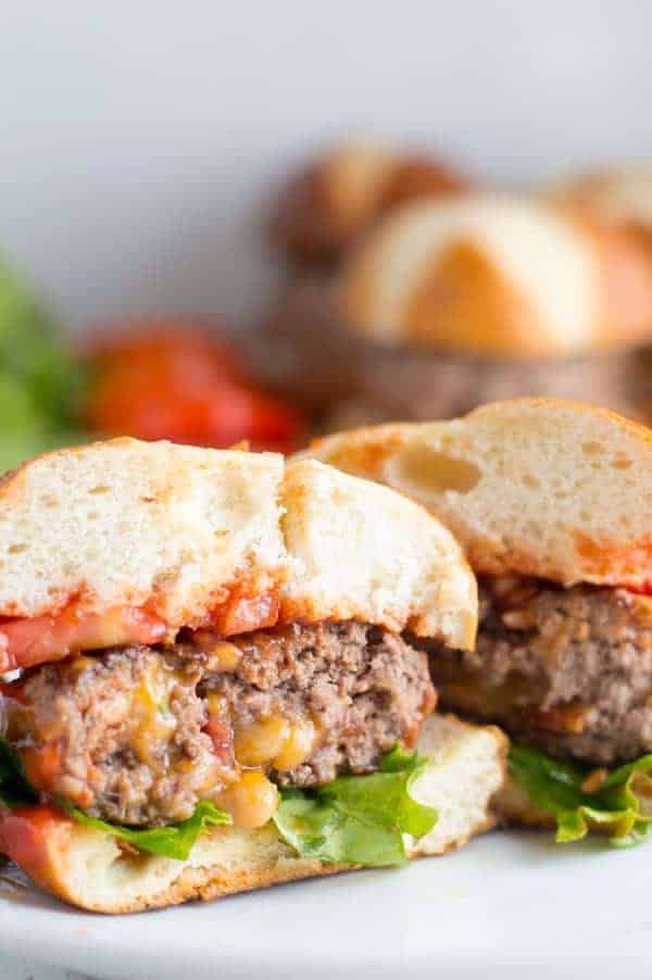 A burger patty stuffed with shredded cheese and bacon is a fun take on the classic bacon cheeseburger. You'll never guess the secret ingredient to make these bacon cheeseburgers perfectly juicy and flavorful!
