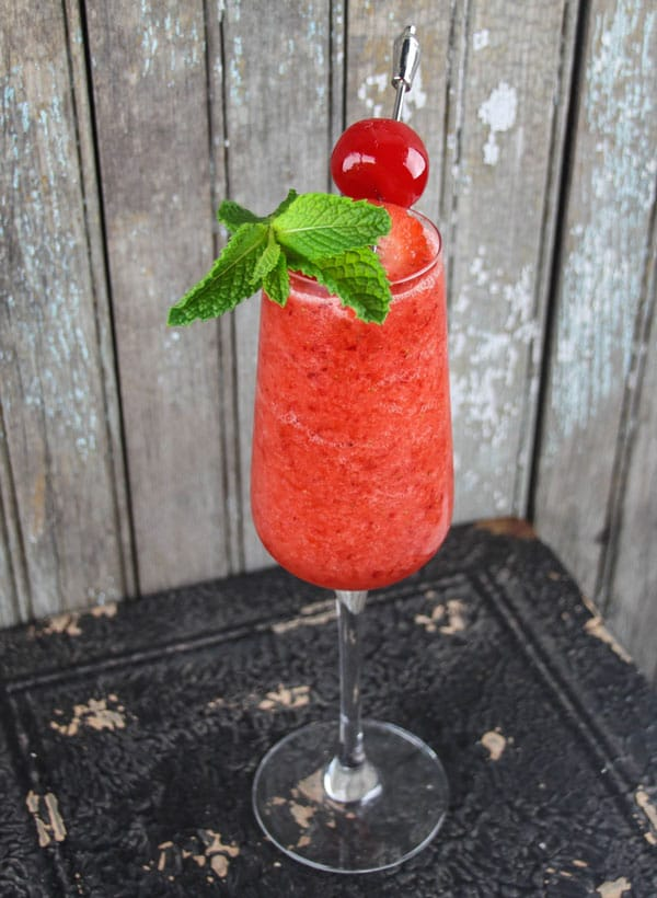Cherry Strawberry Daquiri is a sweet frozen cocktail perfect for a summer's night of fun!