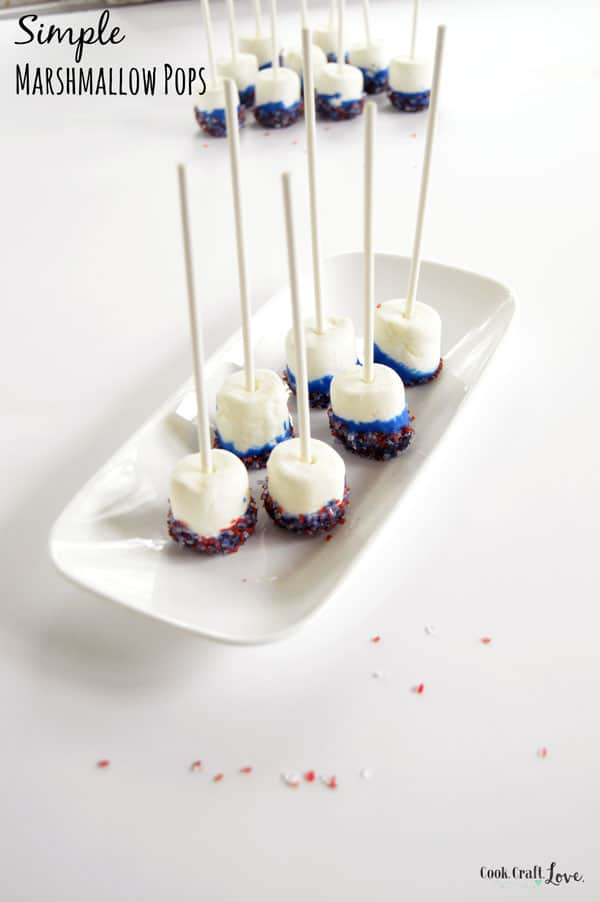 Simple DIY Marshmallow Pops are so easy the kids can make them but elegant enough to serve them at your next party, baby shower, or holiday gathering as a fun marshmallow pop centerpiece and easy treat.