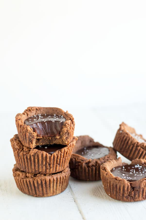 Dark chocolate is transformed into a creamy decadent ganache with a chocolate shortbread crust in these sinful dark chocolate ganache tartlets. You won't be able to eat just one!