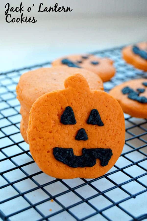 Get ready for Halloween with these super simple Jack o' Lantern cookies! Starting with dough already dyed and you'll save yourself an extra step and more time with these fun Halloween treats!