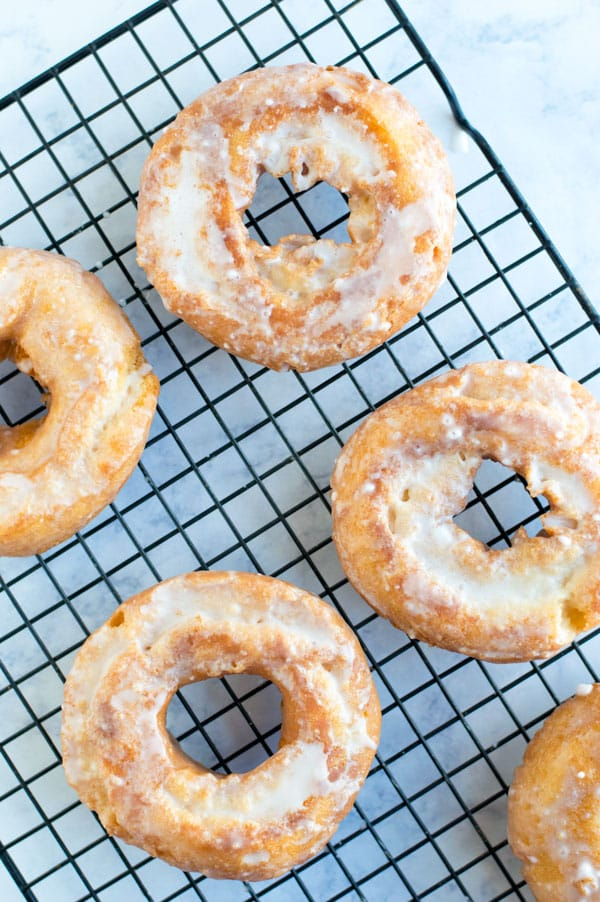 Whether you spell it donut or doughnut you can't go wrong with these easy and delicious old fashioned homemade sour cream doughnuts!