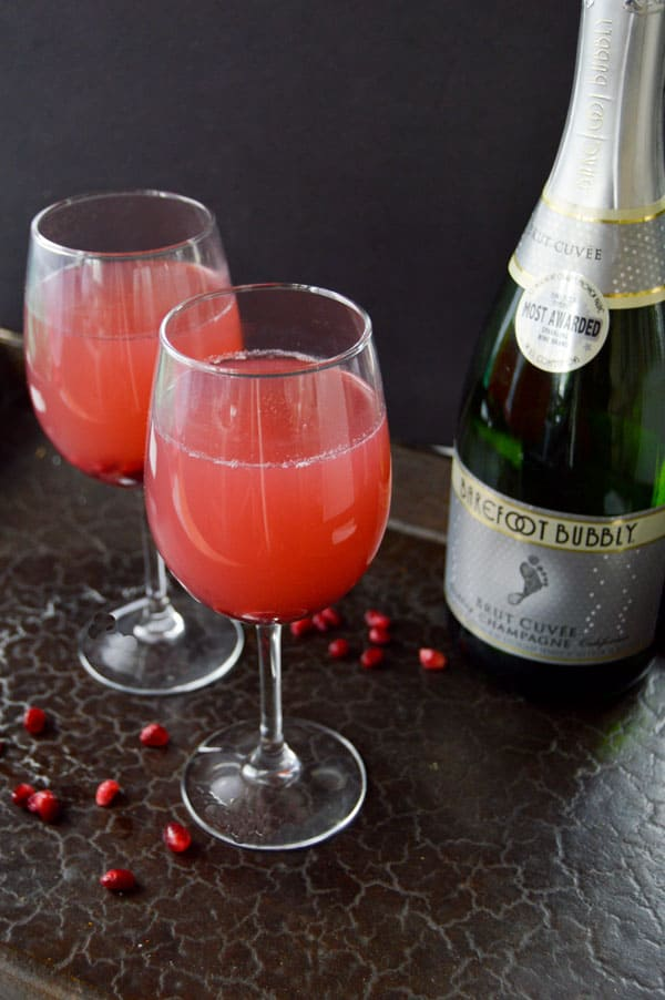 Pomegranate and Champagne create the perfect sweet and tart cocktail for your holiday parties or New Years Eve celebrations!