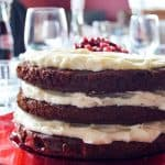Chocolate cake with mascarpone frosting and pomegranates is a sweet finish to any holiday dinner and perfect for any decadent dessert!