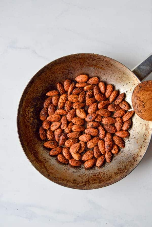 Almonds are toasted with a mixture of spices for a perfect party snack or gift for friends, teachers, and neighbors!