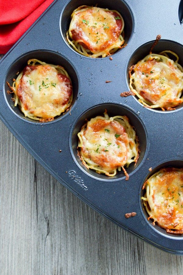 Mini spaghetti pies are a fantastic leftover recipe that are perfect for leftovers and little hands!