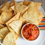 Tortilla chips are made completely from scratch with homemade tortillas and are best served warm with fresh salsa!