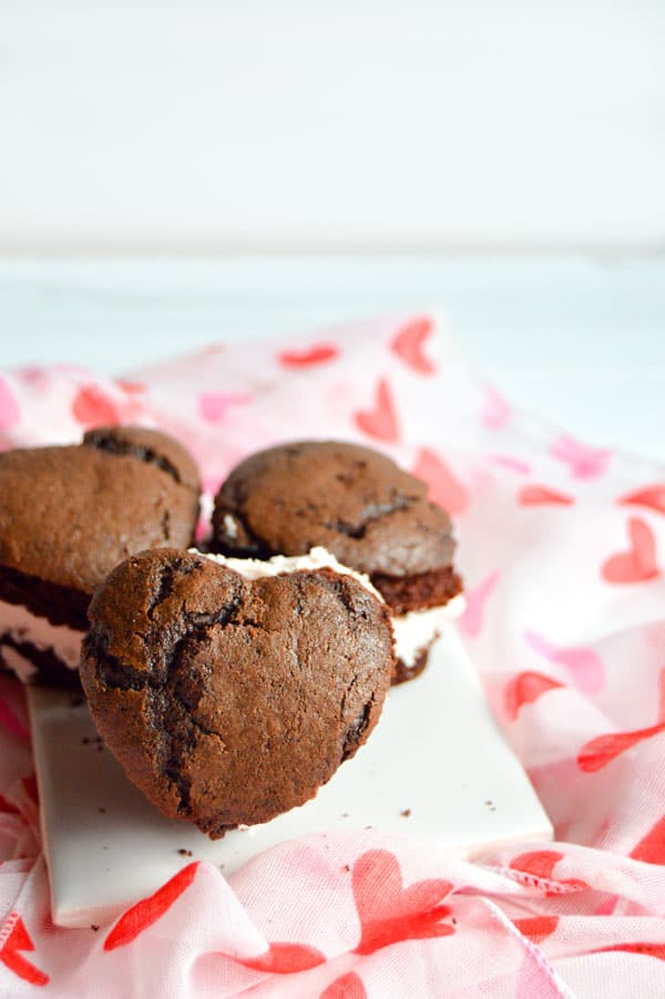 Whoopie pies are an American classic. These heart shaped pies are chocolaty and full of rich raspberry buttercream.