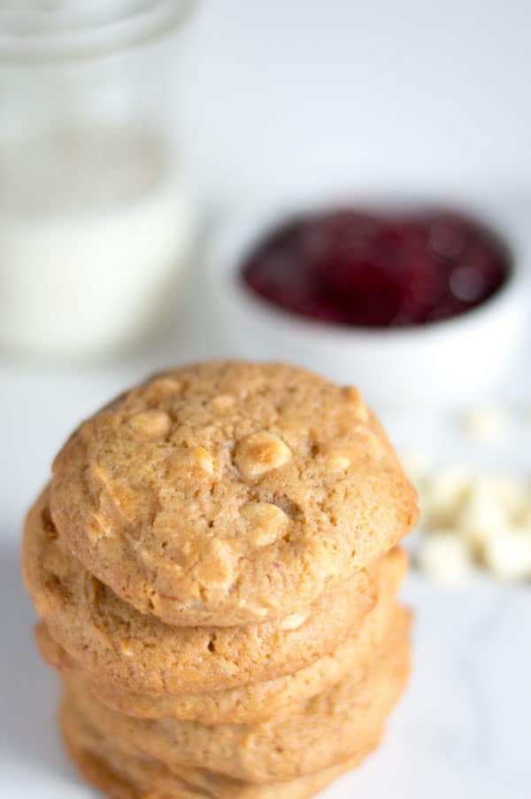 Raspberry jam lends a subtle raspberry flavor to these soft and chewy raspberry white chocolate chip cookies!