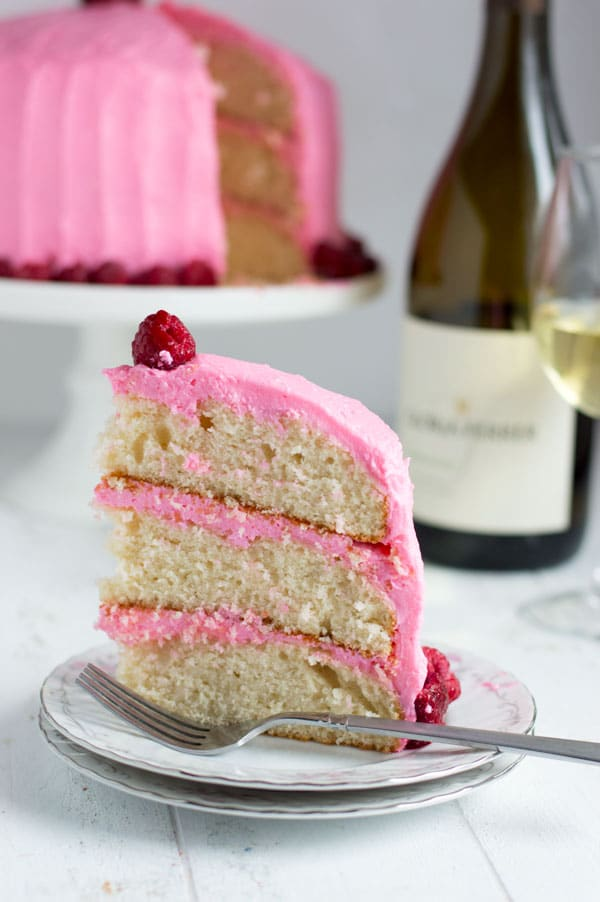 This chardonnay cake is moist with the perfect crumb and topped with sweet raspberry buttercream. It's a great spring recipe and perfect for entertaining!