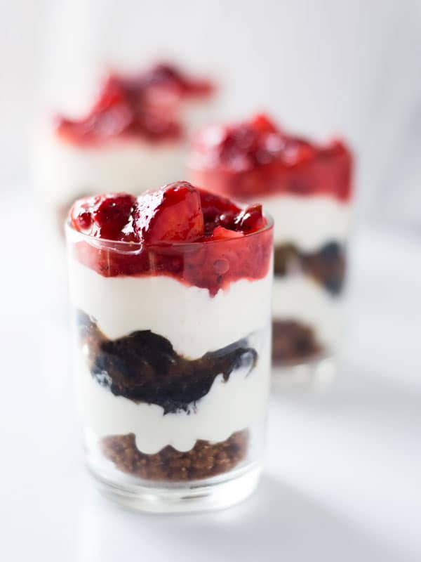 Beautiful summer berries make these festive no bake cheesecake shooters perfect for your Memorial Day or 4th of July bbq!