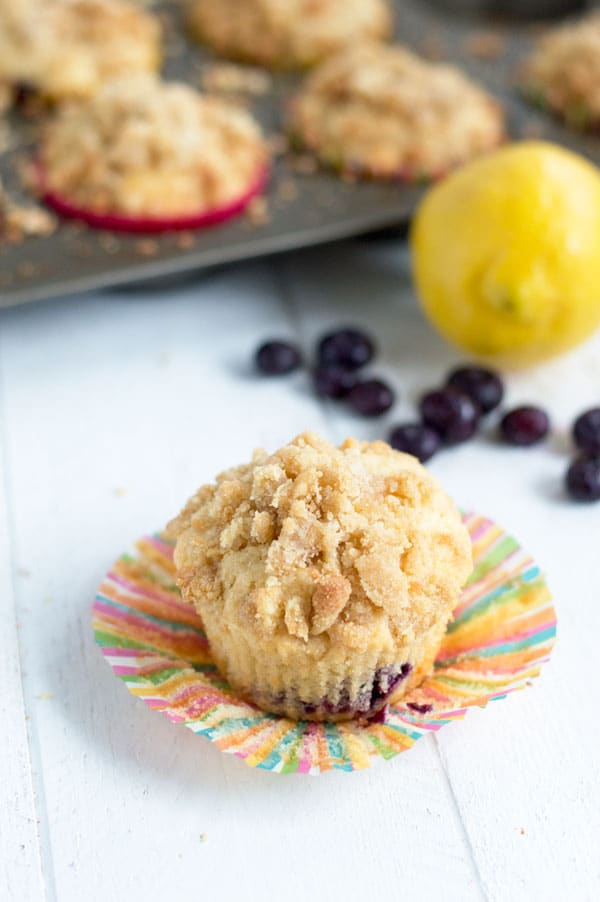Tart lemon and sweet blueberries come together in these lemon blueberry coffee cake muffins for a sweet muffin perfect for breakfast or brunch!