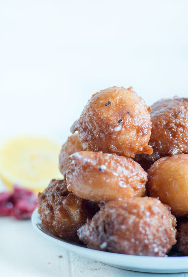 These simple 20 minute donut holes are great for a quick weekday breakfast treat or a simple addition to your brunch table. Filled with lemon curd and coated in a raspberry glaze they're great for spring!