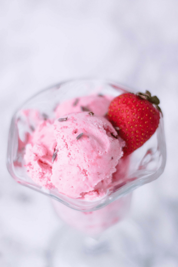 Strawberry lavender ice cream is a sweet summer treat that's fresh and perfect for hot days.