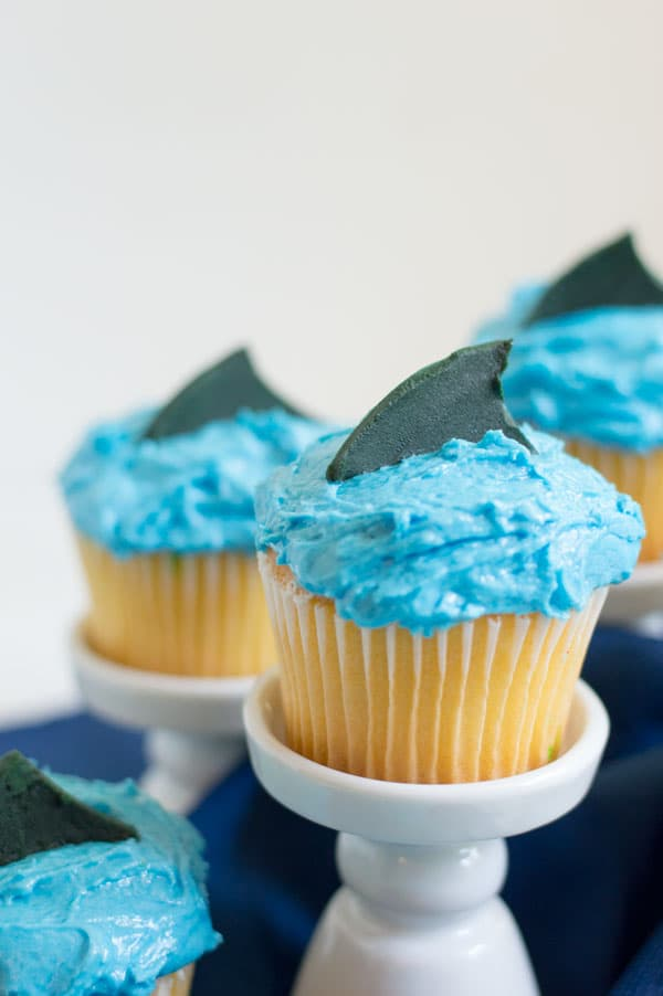 These adorable and simple cupcakes are perfect for your next Shark Week viewing party or day at the beach!