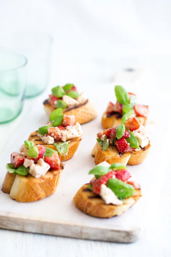 I'm so excited to have Claire from Sprinkes and Sprouts here sharing her amazing Strawberry and Feta Bruschetta! It's the perfect summer appetizer for a crowd!