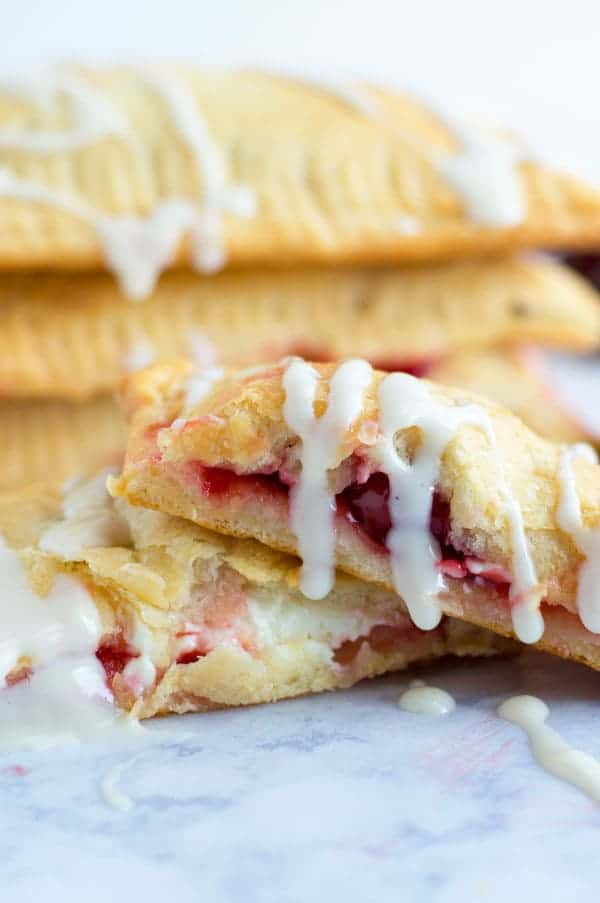 Creamy cheese cherry toaster strudels take me back to my childhood! Serve these babies up for breakfast or dessert!