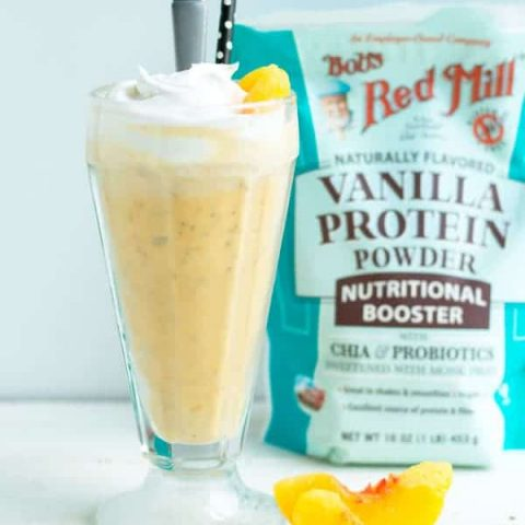 This healthy peach protein milkshake is a deceptively easy snack that's great for a midday treat!