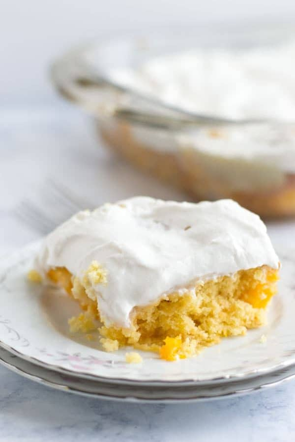 This tropical mango poke cake is the perfect marriage of tropical Hawaiian flavors and a fun southern classic dessert. This tropical poke cake is perfect for National Hawaiian Foods Week!