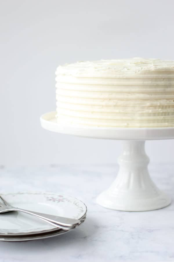 This is Best Homemade Carrot Cake Recipe You'll Ever Make. No, really. This really is the best homemade carrot cake recipe you'll ever make. Moist, perfectly spiced, and without getting carrot shreds stuck in your teeth! Your families will love this easy dessert. Plus it is topped with decadent cream cheese frosting. #carrotcake #homemade #recipe #dessert #cake