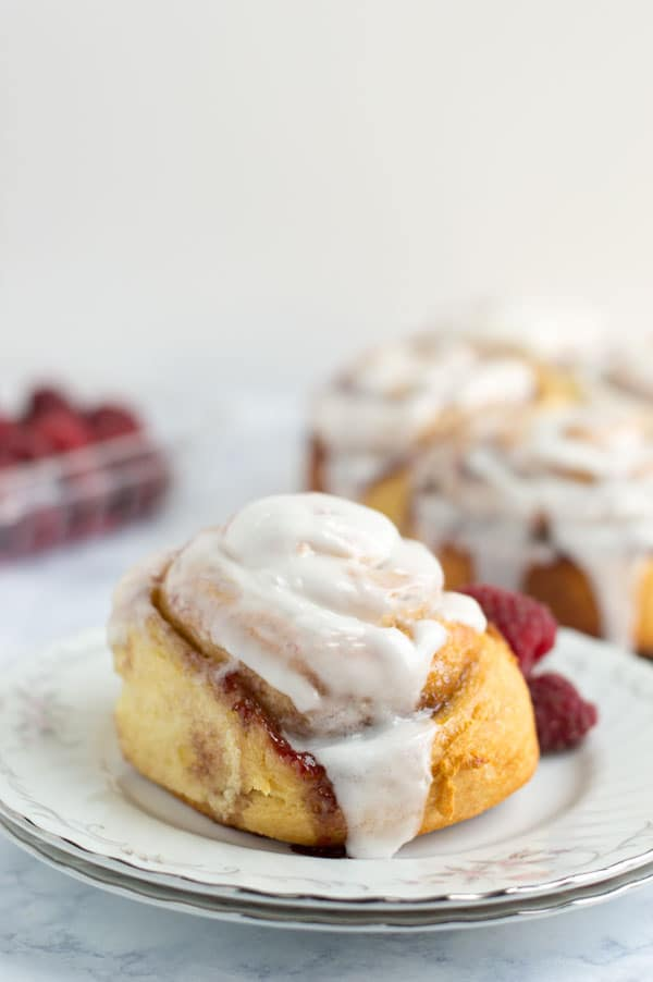 Lemon raspberry sweet rolls are full of fresh raspberry jam and tart lemon juice. They're the perfect sweet roll for your brunch table!